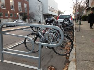 An innovative bike rack taking up one parking space outside a popular breakfast spot in Cambridge, MA. How cool would this be somewhere? Photo by author.